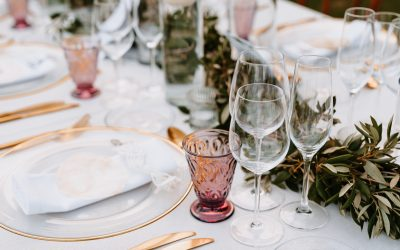 Beautiful Boho Wedding Table Decoration with olive branches and rose drink glasses in Majorca. Selective focus